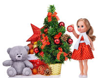 Composition with teddy bear christmas tree doll and santa claus bag Stock Photos