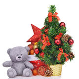 Composition with teddy bear christmas tree and santa claus bag Royalty Free Stock Photos