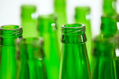 Composition with ten green beer bottles. But only two bottles in focus Stock Photos