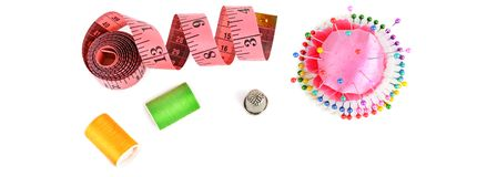 Composition with threads and sewing accessories isolated on white background. Wide photo royalty free stock photography