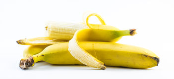 Composition of three bananas one of them is peeled on a white background Royalty Free Stock Photography