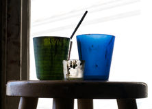 Composition of a three cups and part of a brush on a chair Royalty Free Stock Photography