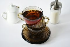 Composition of three cups of tea on the table stock image