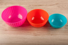 Composition of three different size plastic containers on table Royalty Free Stock Photos