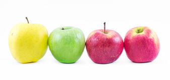 Composition of three types of apples lined up next to each other on a white background - green, yellow and red - still life Royalty Free Stock Photo