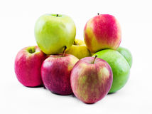 Composition of three types of apples on a white background - green, yellow and red - still life Royalty Free Stock Photos