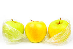 Group of three unpeeled apples on a white background Royalty Free Stock Photo