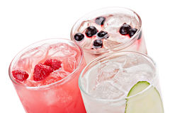 Composition of the three variants of alcoholic cocktails. Composition of the three variants of alcoholic cocktails, isolated on white background.Top view Royalty Free Stock Image
