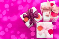Composition three white boxes with a Satin ribbon Bow Background Saturation pink. A festive holiday decoration royalty free stock photos