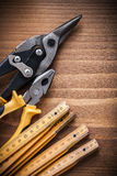 Composition of tin snips pliers wooden meter construction concep Stock Photography