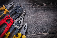 Composition of tin snips steel cutter pliers on Royalty Free Stock Photo