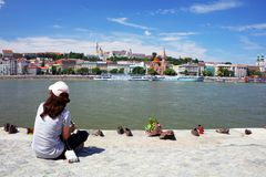 The Shoes on the Danube Bank is a memorial in Budapest,  on the east bank of the Danube River Stock Image