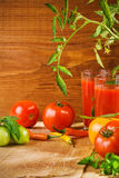 Composition of tomato juice and tomato with peper Stock Photography