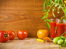 Composition of tomatoes and juice Royalty Free Stock Photography