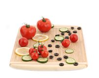 Composition of tomatoes and olives. Stock Image