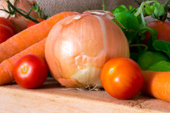 Composition of tomatoes, onion and carrots Stock Photo