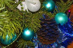 Composition of toys and Christmas tree. Close-up of decorations of toys and Christmas tree with glitter stock image