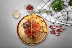 Composition with traditional sliced honey baked ham. On table Stock Photos