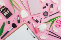 Composition with tulips flowers, cosmetics and accessory on pink background. Top view. Flat lay. Home feminine desk. Composition with tulips flowers, cosmetics stock photos