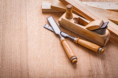 Composition two chisels woodworkers plane and Stock Photos