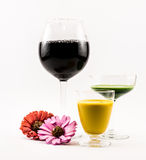 Composition of two cocktails - yellow and green and flowers on a white background Stock Photography
