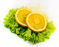 Composition of two slices of orange with salad on a white background Stock Photos