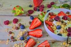 Composition of a typical genuine breakfast made with yoghurt, blueberries, raspberries, blueberries, muesli. Concept of. Fitness, diet, wellness and breakfasts stock images