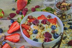 Composition of a typical genuine breakfast made with yoghurt, blueberries, raspberries, blueberries, muesli. Concept of. Fitness, diet, wellness and breakfasts stock image