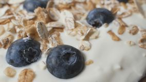 Composition of a typical genuine breakfast made with yogurt, blueberries, muesli. stock video footage