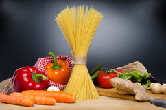 Composition of uncooked spaghetti and different types of vegetab Royalty Free Stock Images