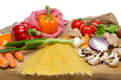 Composition of uncooked spaghetti and different types of vegetab Royalty Free Stock Image