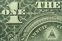 Eye and ONE and THE from a US one dollar bill. royalty free stock photography