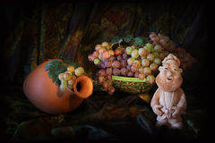 Composition of Uzbek traditional ceramic water vesel, ceramic dish and grapes Stock Image
