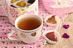 Composition for Valentine's Day. Beautiful bowl of brown drink on a napkin with candy in the shape of a heart royalty free stock photography