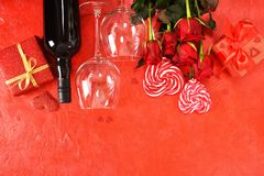 Composition for Valentine`s Day. Roses, gift, glasses and wine, red hearts. Top view. Composition for Valentine`s Day. Roses, gift, glasses and wine, red hearts royalty free stock photos