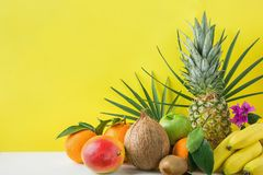 Composition from Variety of Different Tropical and Summer Fruits. Pineapple Mango Coconut Citrus Oranges Lemons Apples Kiwi Banana. S Arranged on Stone Tabletop stock photo