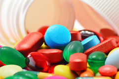 Composition with variety of drug pills and container Stock Photo