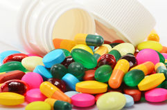 Composition with variety of drug pills and container Stock Photography