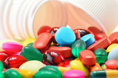Composition with variety of drug pills and container Stock Images