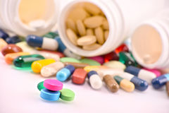 Composition with variety of drug pills and containers royalty free stock photography