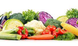 Composition with variety of fresh raw organic vegetables. Over white Stock Photos