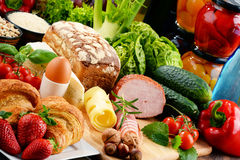 Composition with variety of organic food products. On kitchen table Stock Images