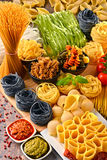 Composition with variety of pasta on kitchen table Stock Photography