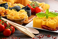 Composition with variety of pasta on kitchen table Stock Photos