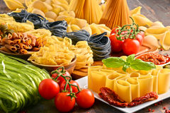 Composition with variety of pasta on kitchen table Royalty Free Stock Images