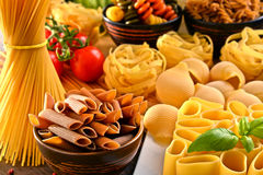 Composition with variety of pasta on kitchen table Royalty Free Stock Photography