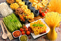 Composition with variety of pasta on kitchen table Stock Photo