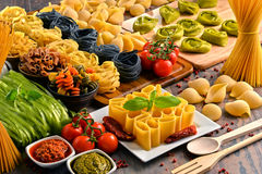Composition with variety of pasta on kitchen table Royalty Free Stock Image