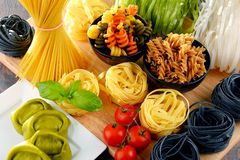 Composition with variety of pasta on kitchen table Stock Images