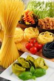 Composition with variety of pasta on kitchen table Royalty Free Stock Photo
